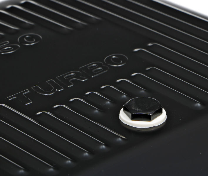 Close-up photo of drain plug and pattern on deep GM TH350 transmission pan